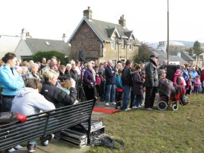 Crowd at the unveiling of the Juniper Green monument