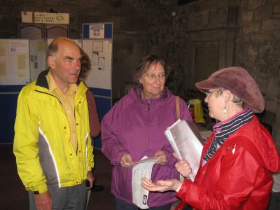 Peter and Val Hawkins listen to Julie Watt's description of the paper-makers' graves in the kirkyard
