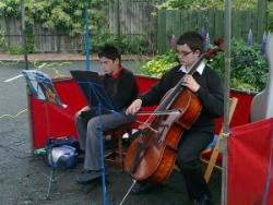 A young cellist entertains the crowd at the June Farmers' Market